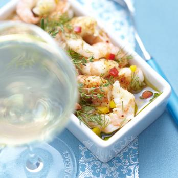 Marinated plancha-cooked king prawns